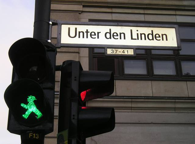 Street name with the range of house numbers; notice also the East Berlin Ampelmännchen