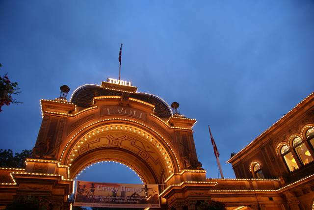 The Tivoli amusement park's main entrance at nighttime